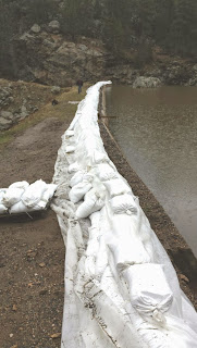 Sand bags in place on a dam crest to prevent overtopping