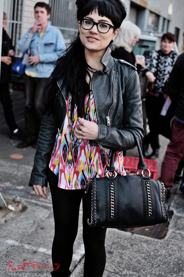 Street Fashion Sydney - Black leather jacket tie-dye shirt black leggings boots and hipster glasses, 60's retro style