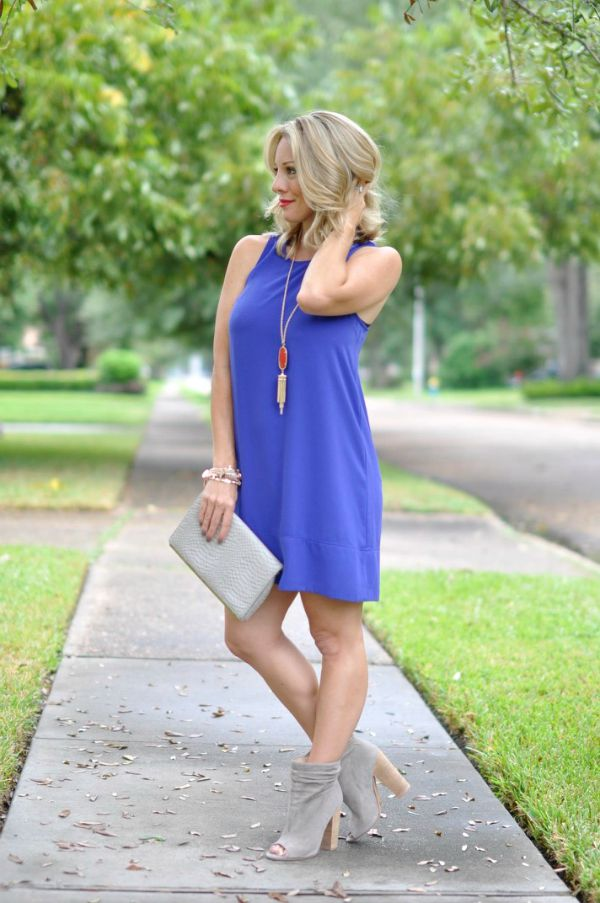 This racerback dress can be dressed up or down and love the look for Fall with booties!