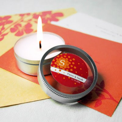 Personalized labels with travel candle favors from Beau-Coup