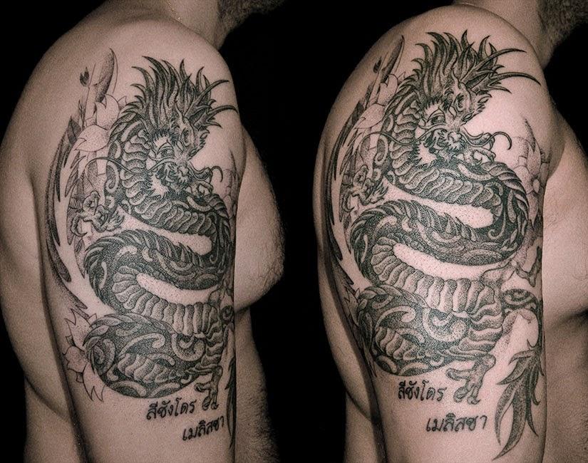 Photo Tatouage dragon sur l'avant bras d'un homme - tatouage dragon avant bras