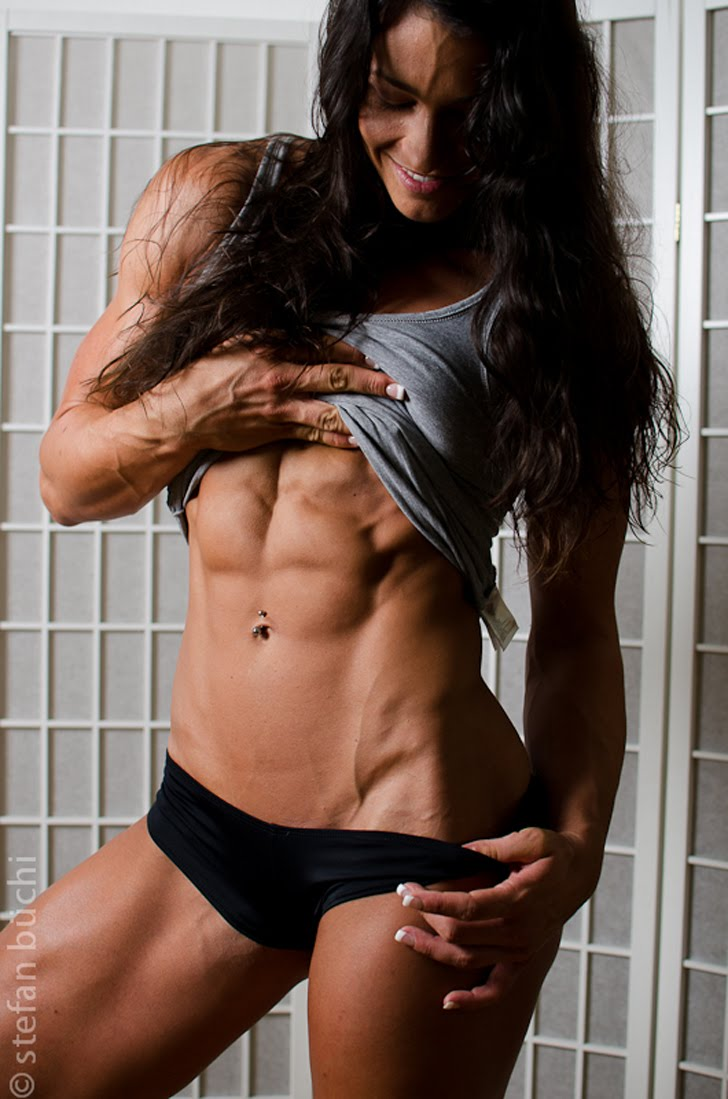 Cindy Landolt Flexes Her Washboard Abs And Fit Body