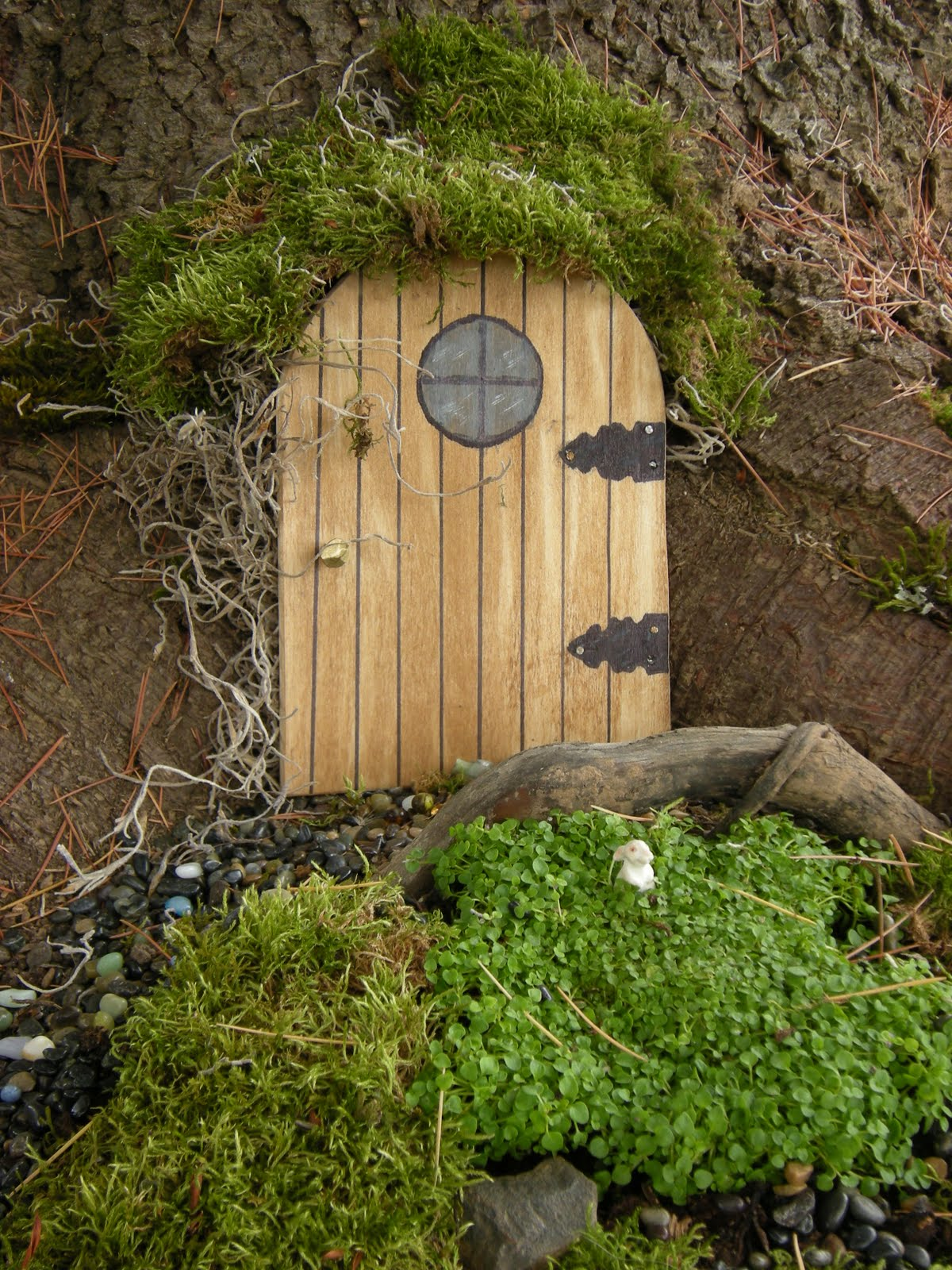 The knitted garden faeries in my garden for Outdoor fairy door