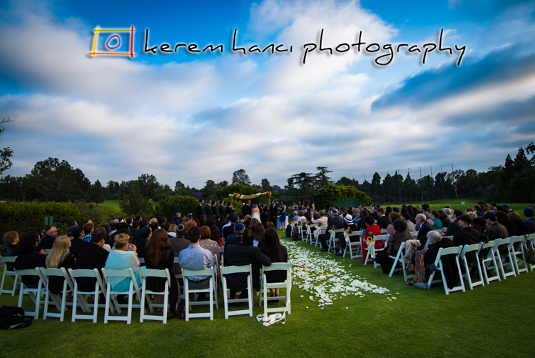 Wedding Ceremony under the blues sky at Hillcrest Country Club