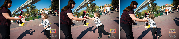 Vivienne meets a little doll version of Minnie Mouse during her first visit to Disneyland.
