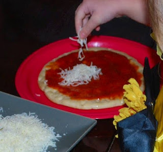 eating out with kids isn't fun, kids making pizza, fun family activity