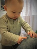 boy touches scrape