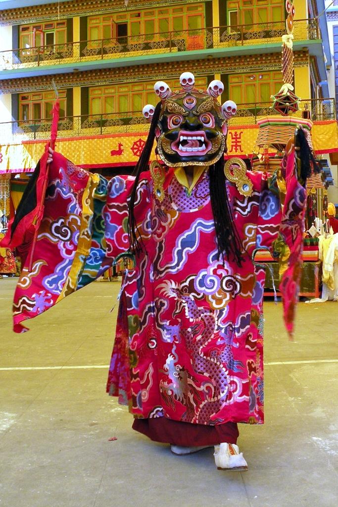 Masked cham dancer during Gutor celebrations