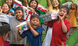 Happy kids receive boxes from Samaritan's Purse