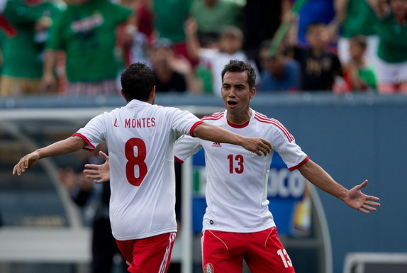 Mexico player Luis Montes celebrates his goal against Martinique with teammate Adrián Aldrete