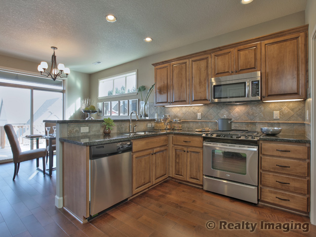 Maple wheat cabinets, Uba Tuba slab granite, walk in pantry, maple