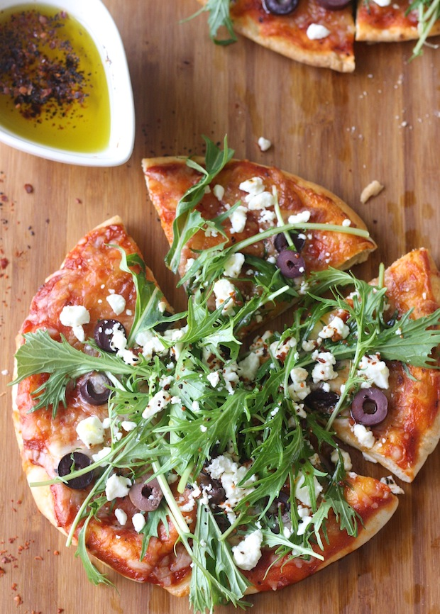 Mediterranean pizza topped with aleppo chili flakes & urfa chili flakes by SeasonWithSpice.com