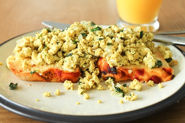 Tofu Scramble with fresh basil on toasted tomato focaccia.