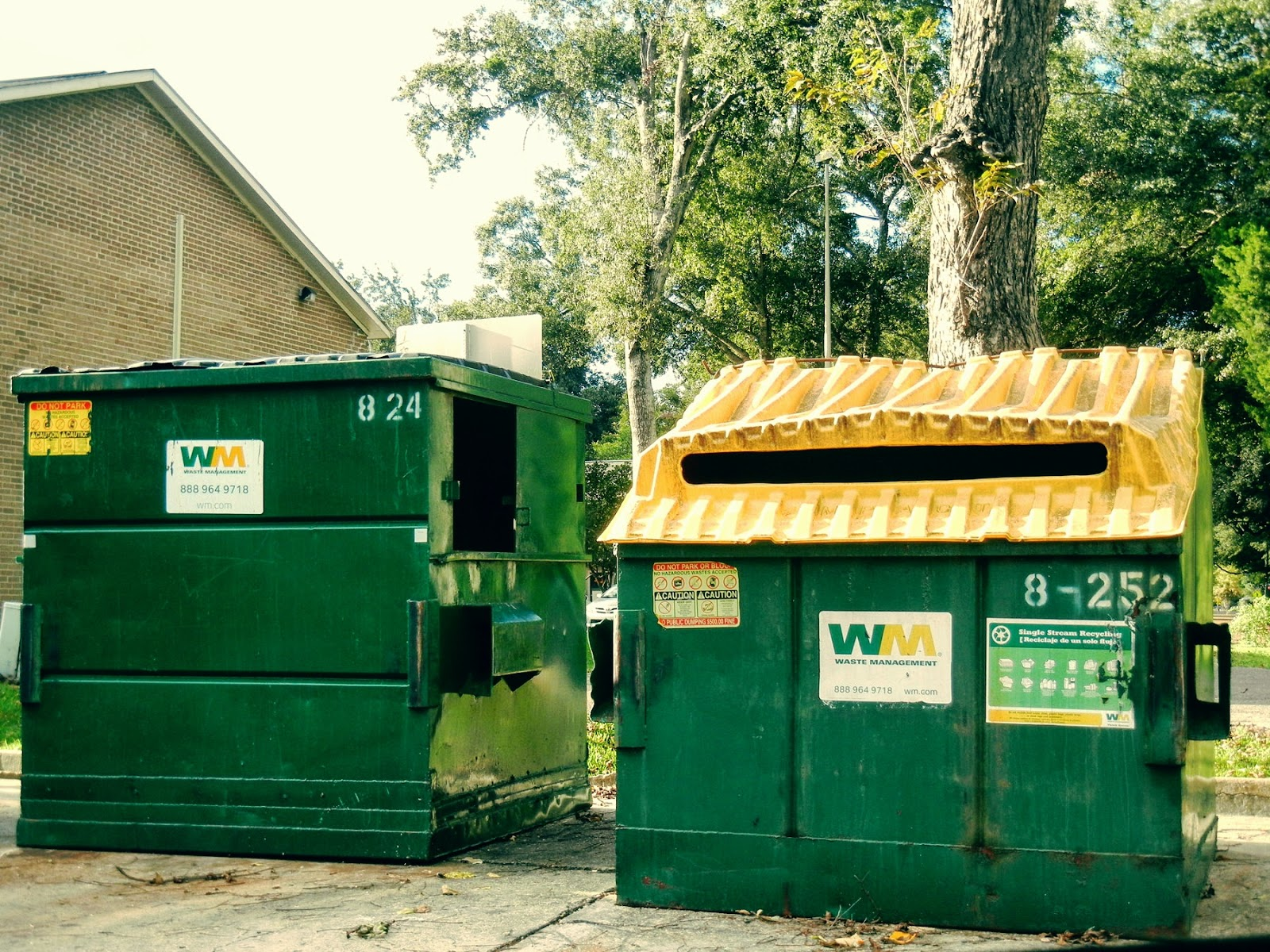 management next to the trash dumpsters now all i had to do was stop on my way out of the parking lot and empty my recycling bin much more convenient