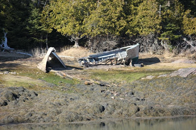 beached and broken boat