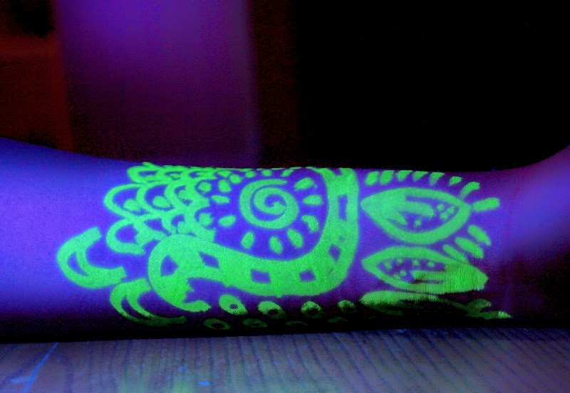 make your skin glow under black light with a highlighter