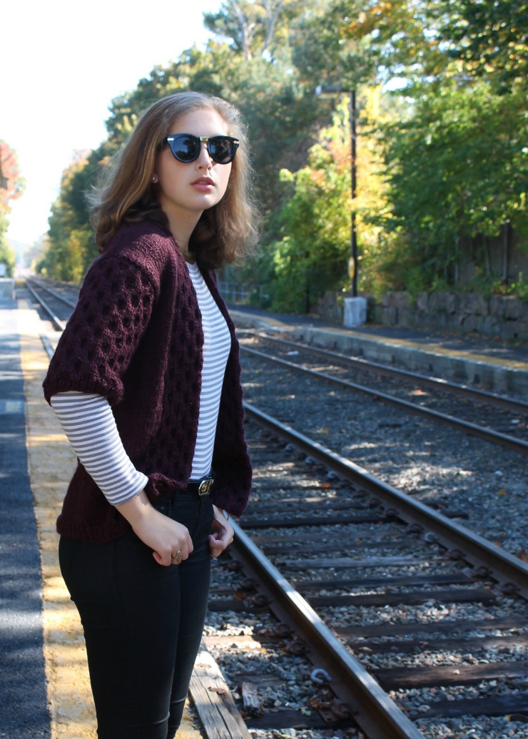 burgundy knit sweater vest and high waisted jeans