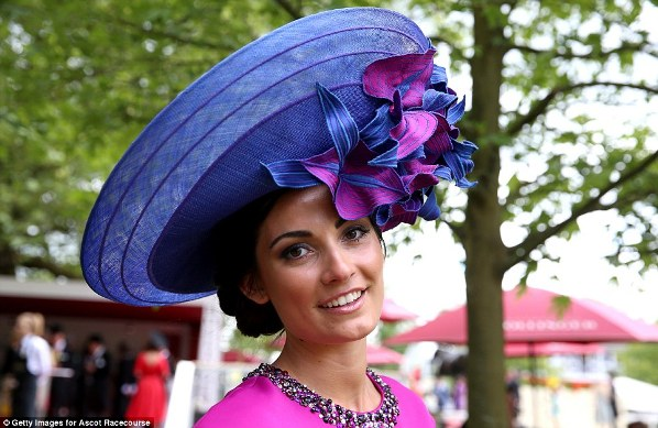 beautiful and elegant lady in purple oversized hat and hot pink dress on day 2 at Royal Ascot 2014