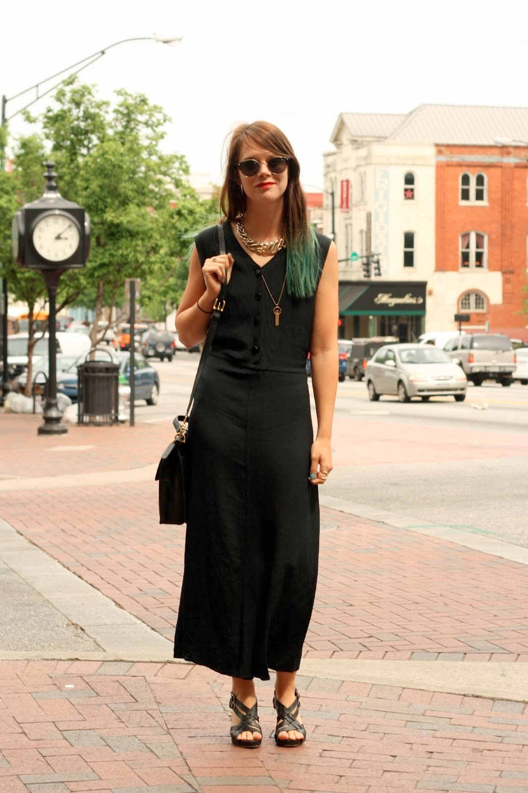 University of Georgia in Athens, GA student wears a long sleeveless black summer dress with leather heel sandals. Keychain necklace