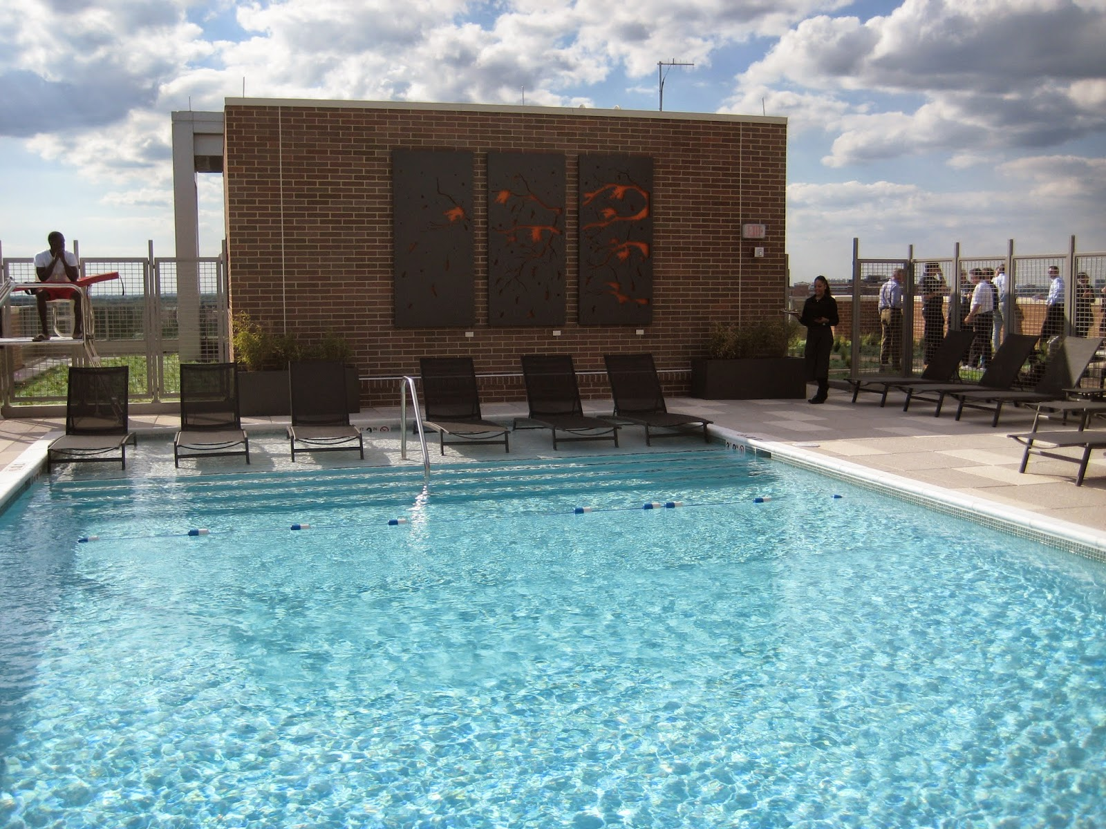 Rooftop Pool, Complete With Artworks And A Lifeguard On Duty