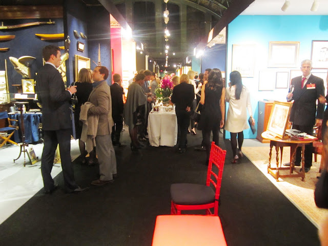 People mingling at the Young Collectors Night at the Winter Antiques Show at the Armory