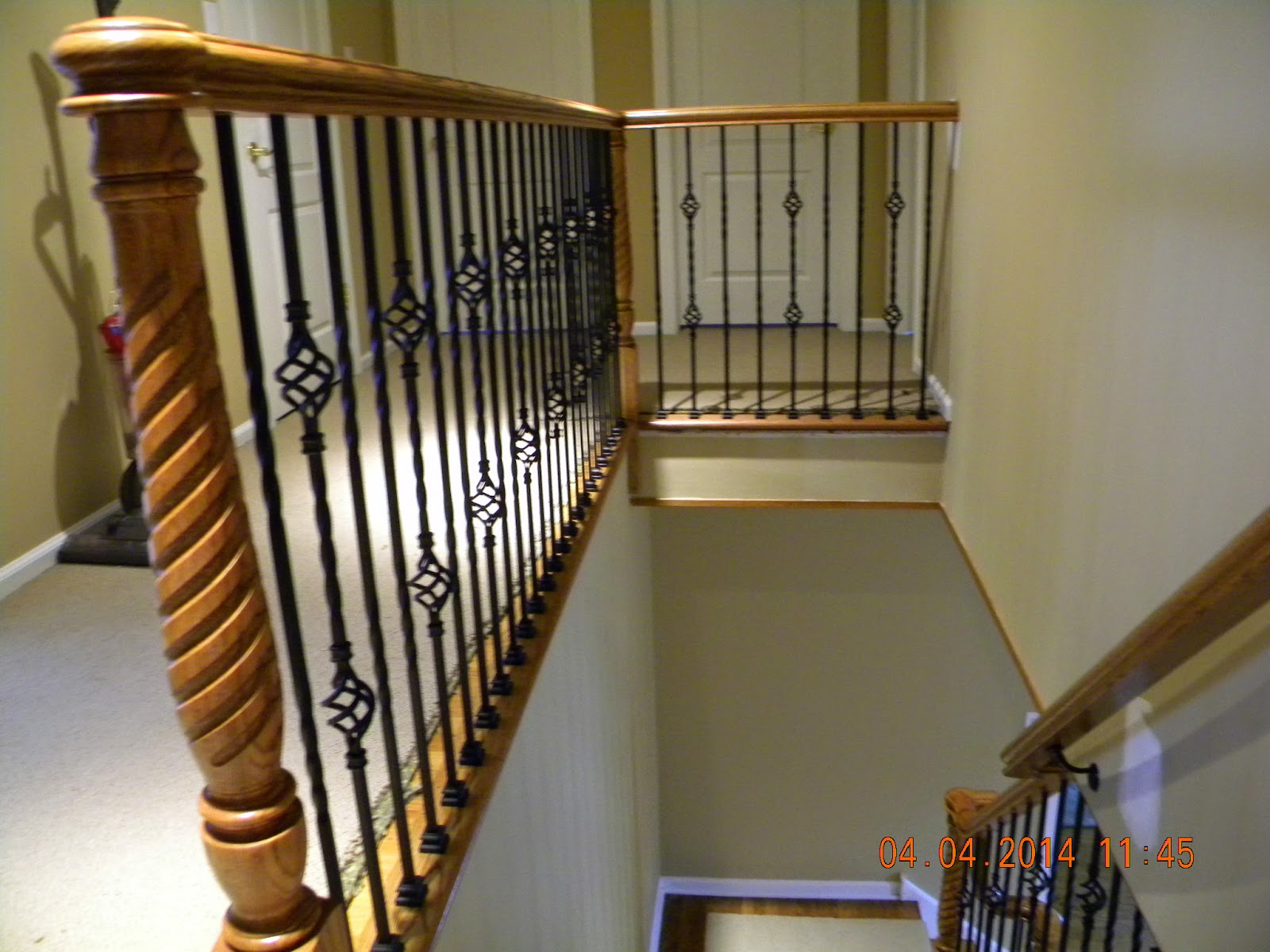 100 wrought iron balusters with wood nautilus scroll wrough