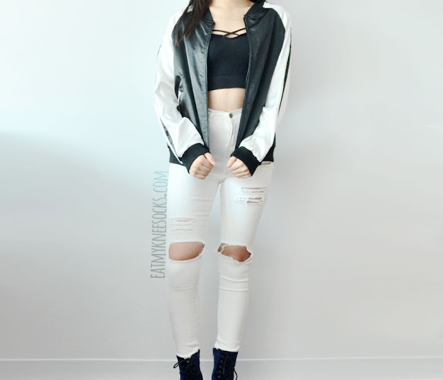 A sporty-chic outfit featuring SheIn's reversible silk satin embroidered Asian-style bomber baseball jacket, paired with white ripped destroyed high-waisted skinny jeans, blue velvet Report high-heeled booties, and a Brandy Melville-inspired cross-front cropped tank top.