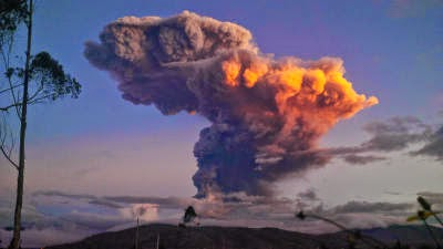 the Tungurahua volcano spews