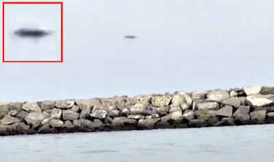 Dark Disc UFO Caught Hovering Over California Beach, UFO Sightings