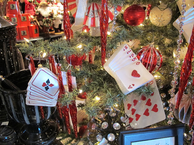 Close Up Of One Of Their Christmas Trees Decorated With A Card Theme