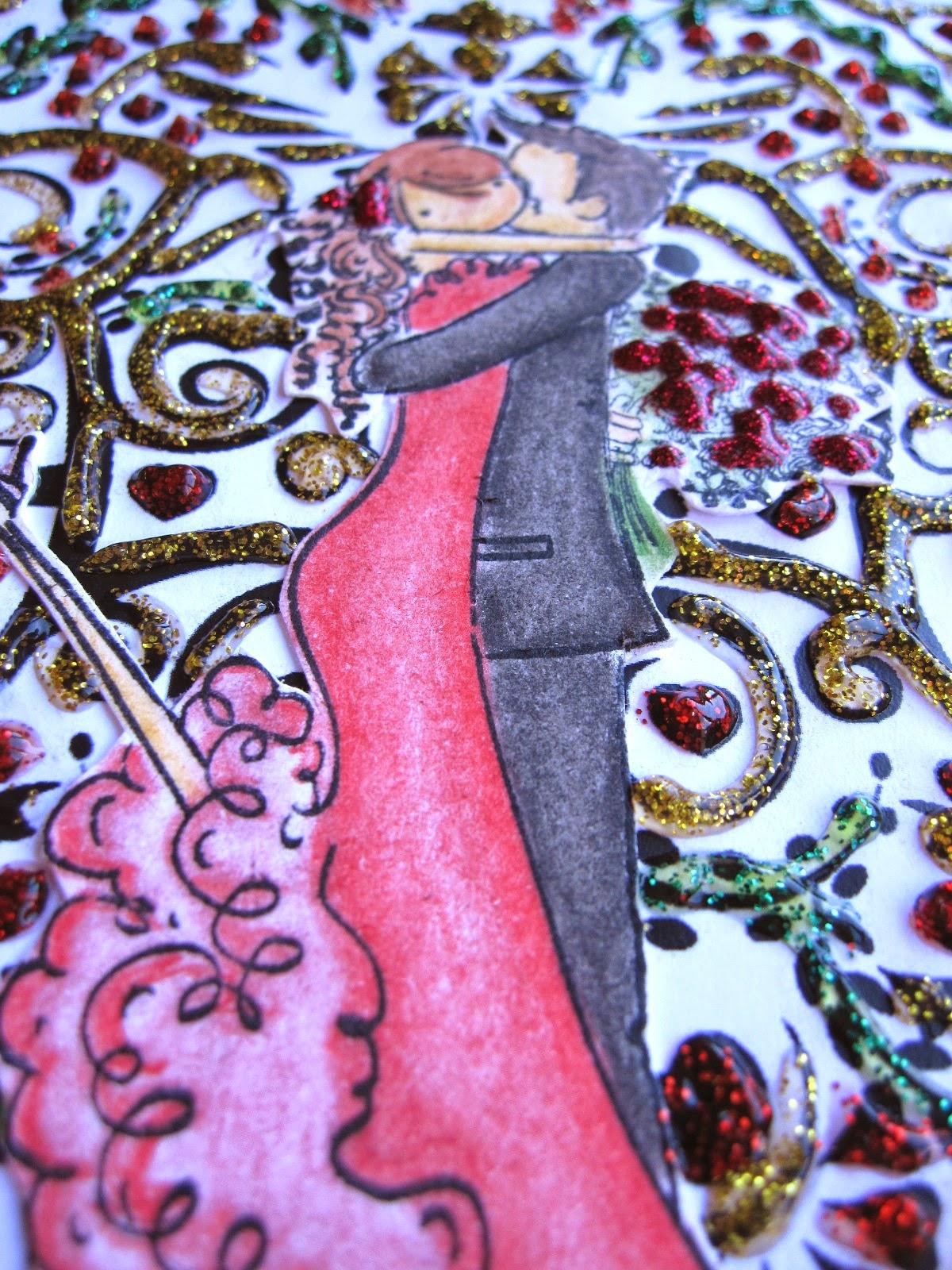 detalle de tarjeta de scrapbooking para San Valentín con corazón de filigrana decorado con glitter glue rojo, verde y amarillo y pareja de novios coloreada besándose