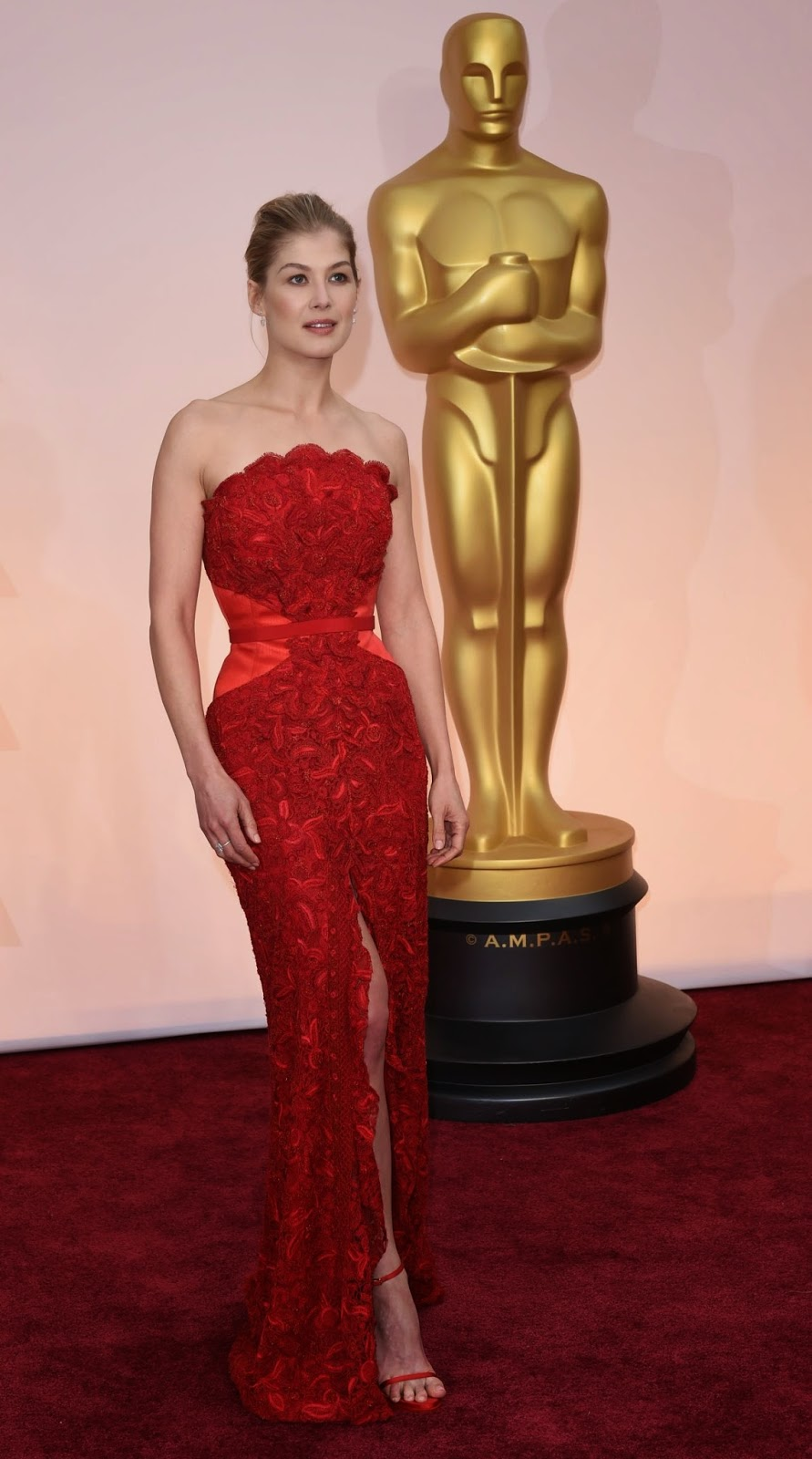 Rosamund Pike is ravishing in red Givenchy at the 2015 Oscars in Hollywood