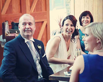 bride laughing at speeches at St Chads place wedding