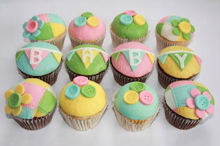 12 pastel Baby Shower cupcakes