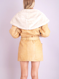 Vintage 1980's Tan shearling coat with large collar and belted tie front closure.