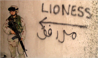 female soldier against beige wall with word lioness