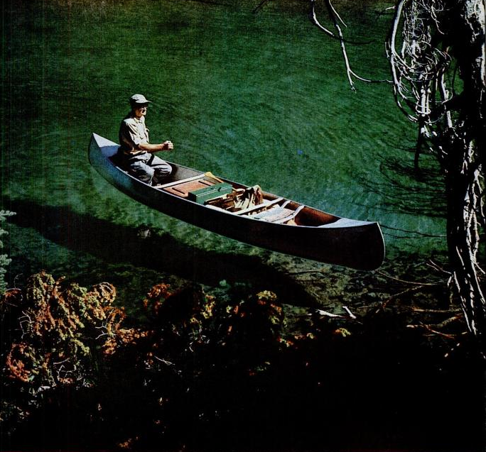 Paul Hosmer in floating canoe on Devil's Lake, Oregon