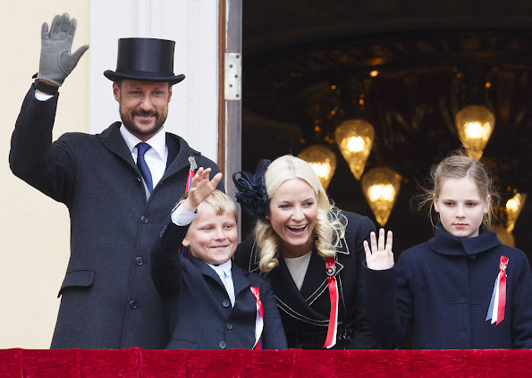 King Harald and Queen Sonja, Crown Prince Haakon of Norway and Crown Princess Mette-Marit of Norway with Princess Ingrid Alexandra, Prince Sverre Magnus and Marius Borg Høiby greet the Childrens Parade on the Skaugum Estate