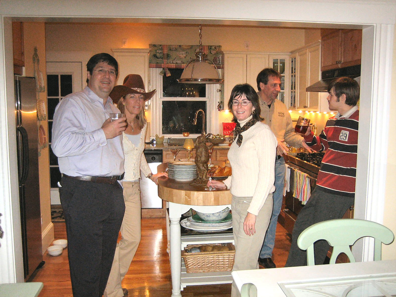 Then: in my bungalow kitchen (I'm in the hat, gift from then boyfriend
