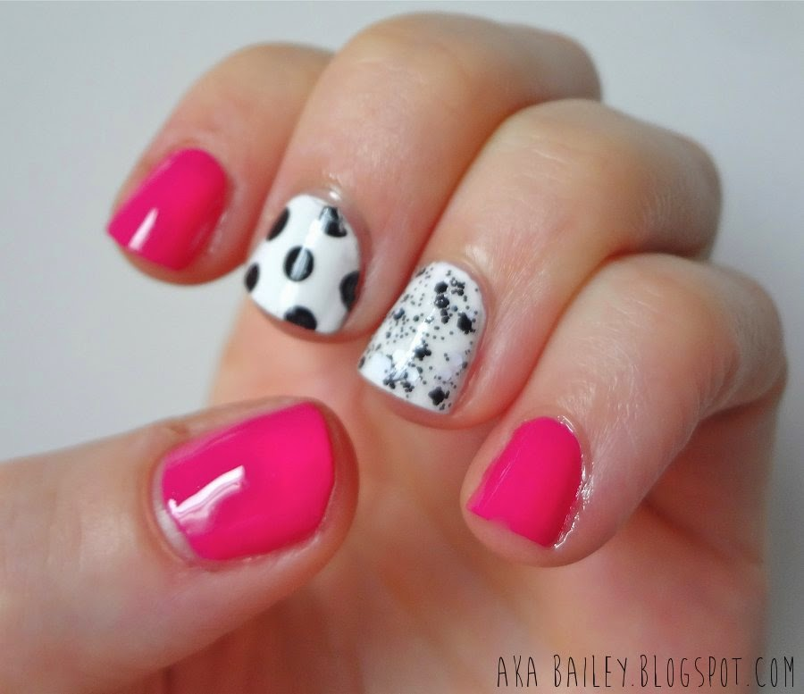 Fuchsia nails with black and white polka dot accent nails