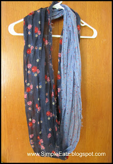 Two colored scarf. Half is light blue. Other half is dark blue with red pink flowers