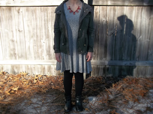 grey swing dress black ankle booties black leggings military jacket red necklace