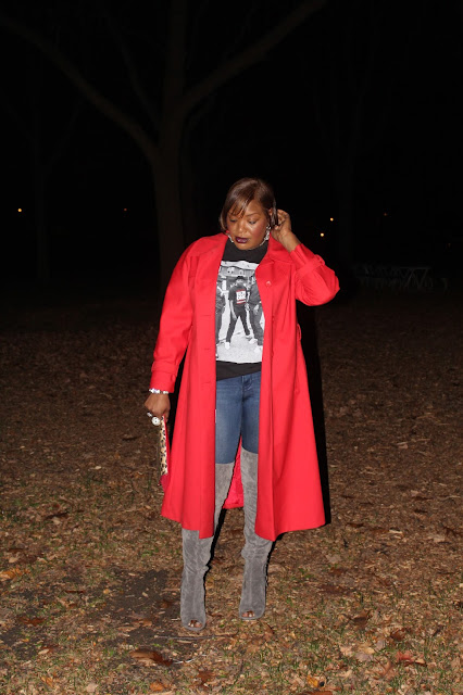 Gray-suede-over-the-knee-boots-worn-with-a-trench-coat-in-an-unexpected-tomato-red-color