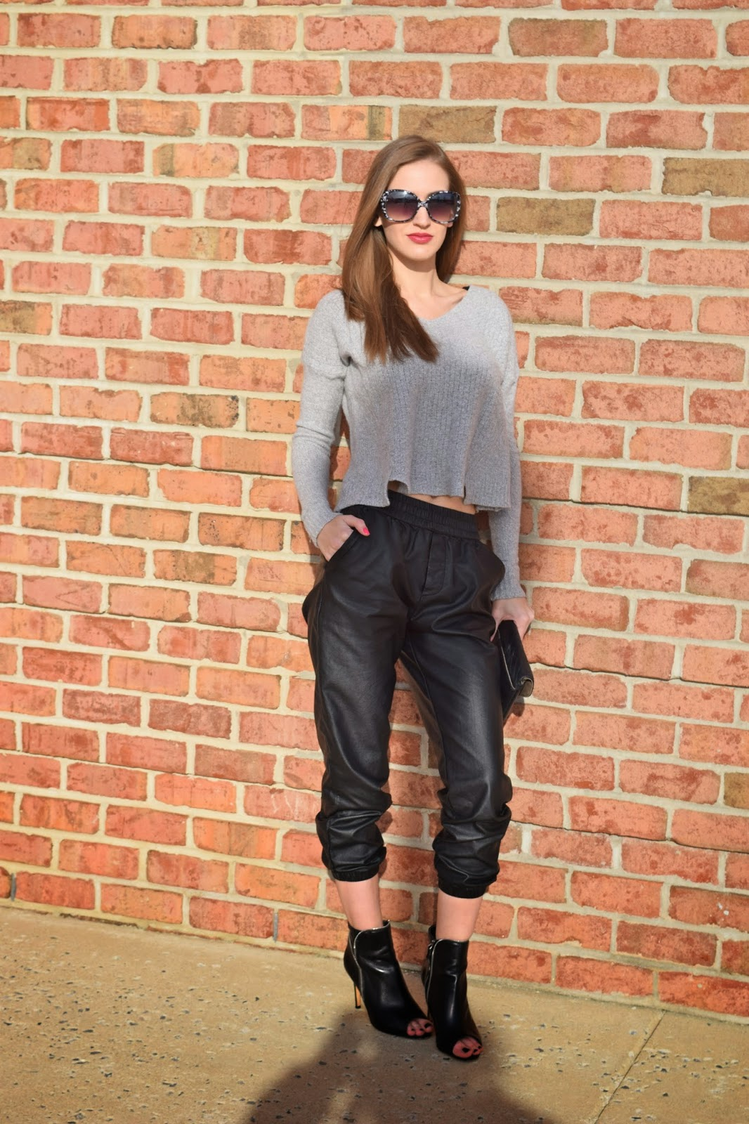 Wearing leather jogging pants, grey crop top sweater, halogen peep toe leather booties