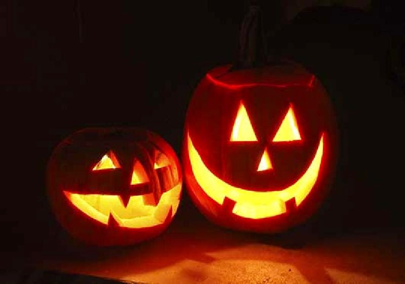 Two jack-o-lanterns lit at night