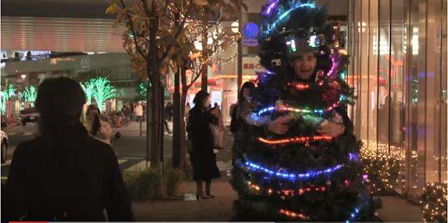 Joseph Tame, a British man, is doing his bit to spread joy this season by dressing up and running around as a Christmas tree in Tokyo.    He made a costume for himself with fake Christmas tree branches, lights and decoration. He dons it along with 99 batteries  and 30 meters of wiring, and begins his daily run.  Surprised Tokyo residents typically burst into laughter and take his photos before sharing them on social media. Local and international media have picked up the story and turned Joseph Tame into a celebrity and a viral phenomenon.