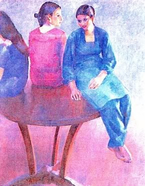 three young women in blues and pinks perched on a round table with their backs to us