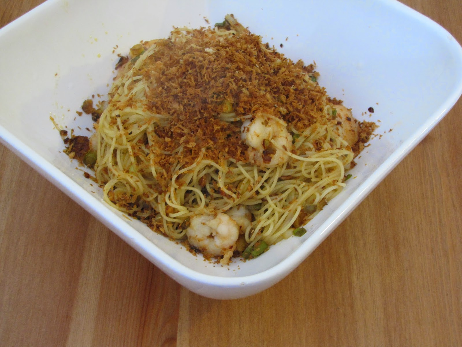Garlicky Pasta With Shrimp Topped with Crunchy Panko Breadcrumbs in a white rectangular bowl