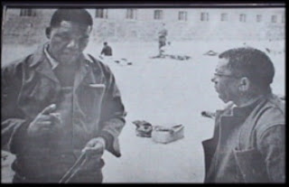 nelson mandela and walter sisulu in the prison yard on robben island