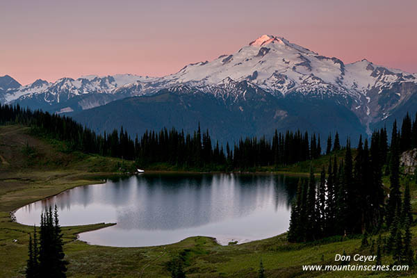 Early light on Glacier Peak above Image Lake in the Glacier Peak Wilderness, North Cascades, Washington, USA.